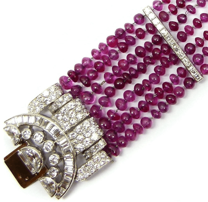 Detail of Art Deco ruby bead and diamond cluster bracelet by Van Cleef & Arpels. Circa 1934. Via Diamonds in the Library.