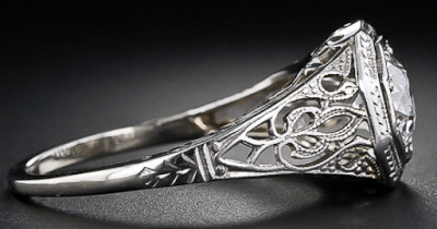 Side view of an Edwardian diamond solitaire and filigree engagement ring, late 1920's. Via Diamonds in the Library.