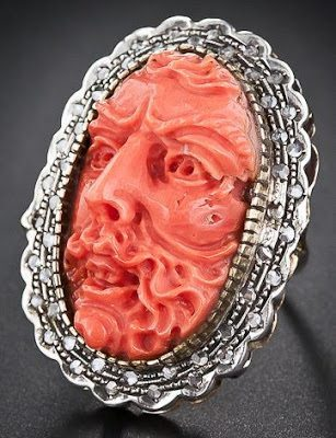 An antique Italian carved coral and diamond ring. Via Diamonds in the Library.