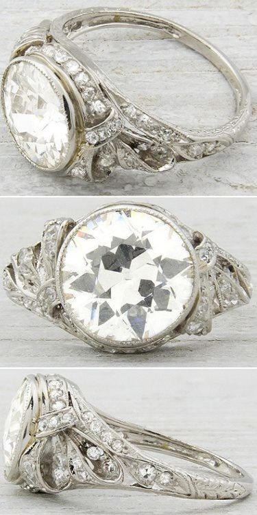 Antique Edwardian or early Art Deco engagement ring, circa 1905. Set with a 2.33 carat old European cut diamond with H-I color and SI1 clarity. Via Diamonds in the Library.