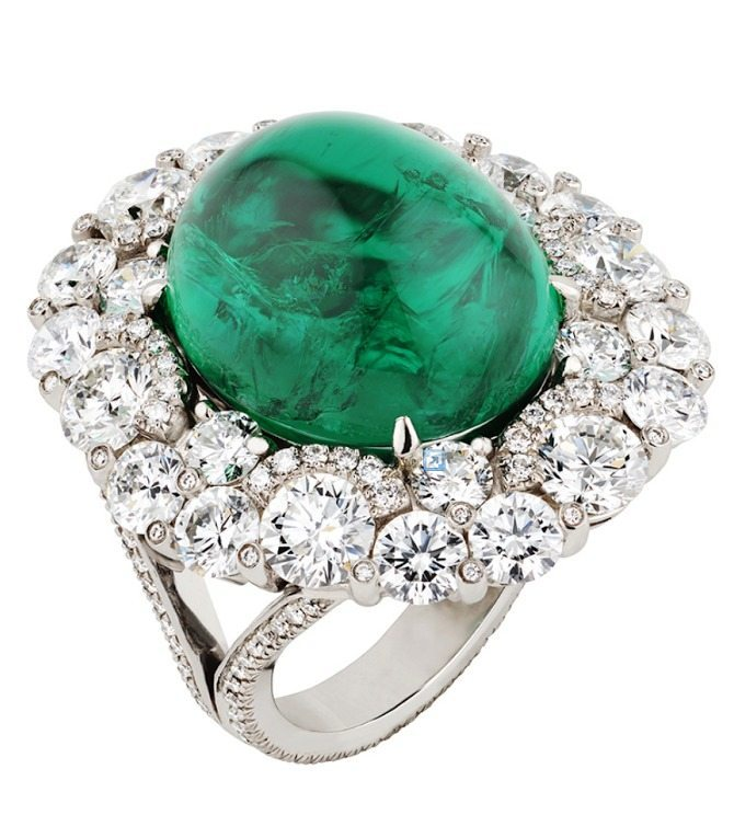 Fabergé's Solyanka cabochon emerald and diamond ring. Centered by a 14.50ct cabochon-cut emerald, set in platinum and set with 263 white diamonds. Via Diamonds in the Library.