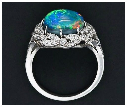 Gallery view; a fire opal and diamond ring from Lang Antiques. Via Diamonds in the Library.