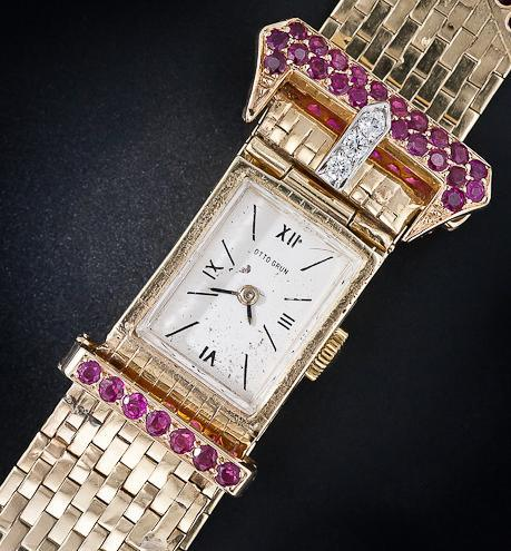 Retro buckle bracelet watch with diamonds and rubies. From the 1940's. Via Diamonds in the Library.