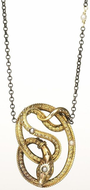 This piece was originally a Victorian stickpin - the original element is the twining snake. The snake is 14k gold and embellished with pearls. Estate of Grace Collection.