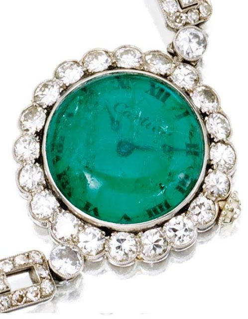 Watch dial detail view of an Art Deco emerald and diamond wristwatch, Cartier.  Via Diamonds in the Library.