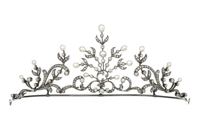 A dainty pearl and diamond tiara designed as a series of scroll and stylized foliate motifs, set with pearls and circular-cut and rose diamonds. It may also be worn as a necklace.