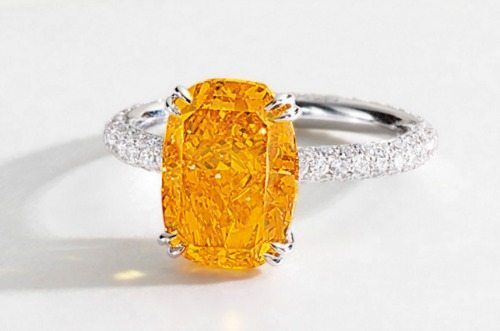 A rare 4.19 carat fancy vivid orange diamond ring. In a white gold with brilliant-cut diamonds. Via Diamonds in the Library.