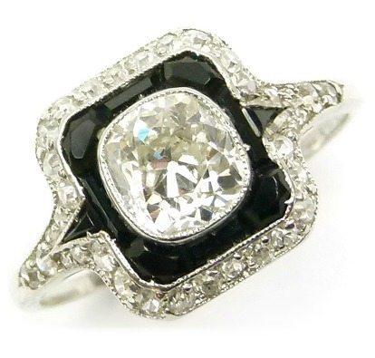 Art Deco onyx and diamond ring, early 20th century.