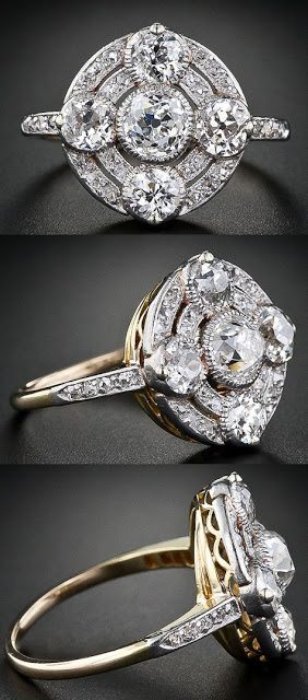Circular antique diamond ring from the early 1900s. Plantinum over gold. Via Diamonds in the Library.