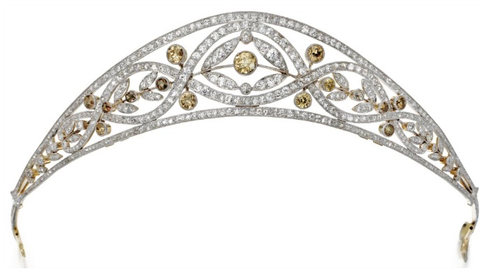 Edwardian tiara, circa 1910. With 6.50 carats of white single-cut and rose-cut diamonds and 3.25 carats colored old-cut diamonds, in gold and platinum.
