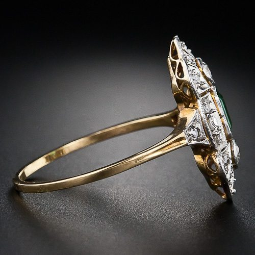 Alternate side view - Art Deco emerald and diamond dinner ring in platinum and gold. Via Diamonds in the Library.
