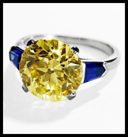 Art Deco Cartier yellow diamond and sapphire ring. It features a 5.50 carat a European-cut fancy intense yellow diamond flanked on either side by shield-cut sapphires weighing a total of 1.20 carats. Via Diamonds in the Library.