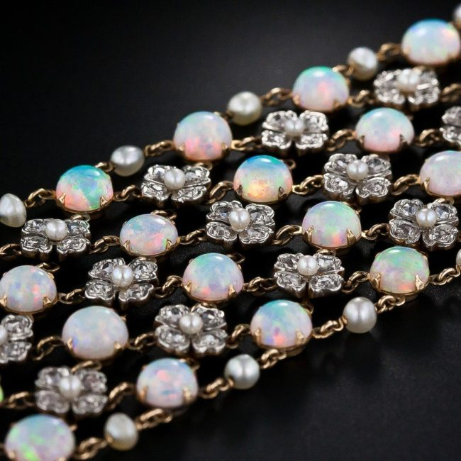 Alternate view: Belle Epoque opal and diamond choker necklace, circa 1900. With four rows of opals and three rows of pearl and diamond flowers, this antique choker has 80 carats of opals (78 stones), 232 rose cut diamonds (7 carats), and 96 pearls. Via Diamonds in the Library.
