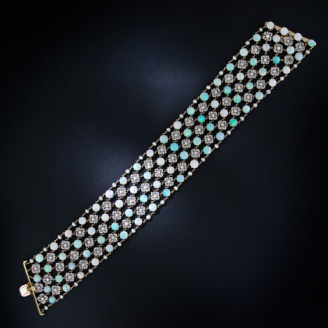 Belle Epoque opal and diamond choker necklace, circa 1900. With four rows of opals and three rows of pearl and diamond flowers, this antique choker has 80 carats of opals (78 stones), 232 rose cut diamonds (7 carats), and 96 pearls. Via Diamonds in the Library.