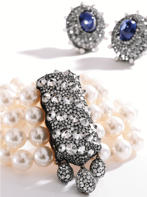 Blackened silver, 18k gold, sapphire, and diamond earrings by JAR, Paris; shown here with a gold, blackened silver, diamond and pearl bracelet also by JAR, Paris. Via Diamonds in the Library.