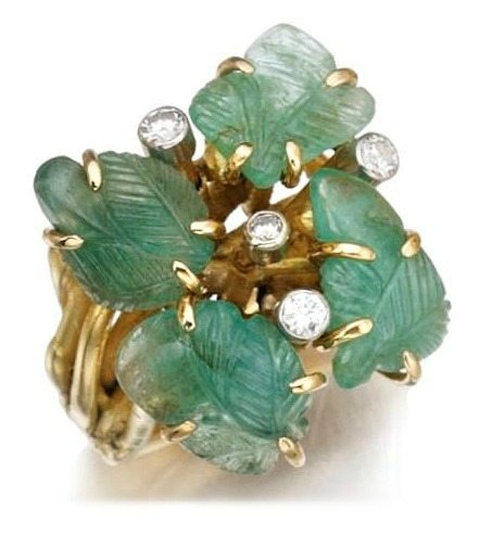 Gem-set anda diamond ring by Cannilla, Masenza. This ring is made of gold and set with carved emeralds and brilliant-cut diamonds. Via Diamonds in the Library.