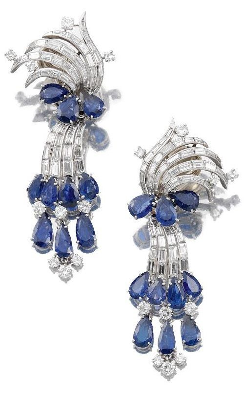 Sapphire and diamond earrings by Cartier. Set with pear-shaped sapphires and brilliant-cut and baguette diamonds. The bottom pendants detach.