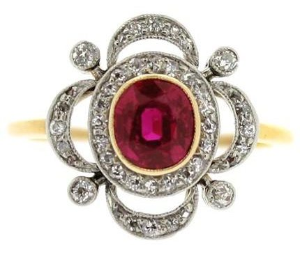 This antique ruby and diamond cluster ring was made in 1905. The ring is yellow gold with platinum, the central ruby is 1 carat, surrounded by 0.44 carats of diamonds.