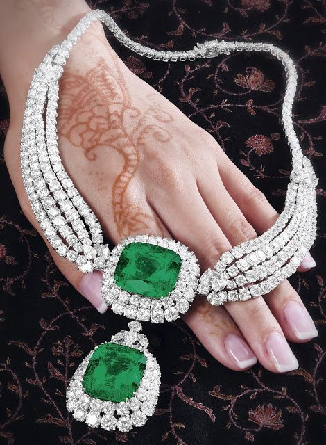 An emerald and diamond necklace, by Cartier. This piece features two large emeralds (44.42 and 42.50 carats) surrounded by 75 carats of diamonds.Via Diamonds in the Library.