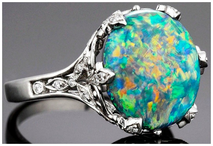 Black opal and diamond ring by Tiffany & Co. Via Diamonds in the Library.