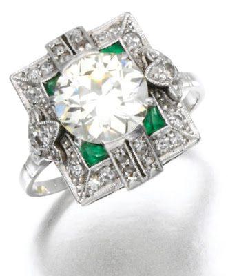 Art Deco emerald and diamond ring, circa 1910. The center diamond - a circular cut stone of 2.07 carats.