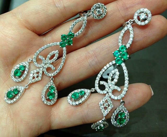 Emerald and diamond earrings by Sasha Primak. Via Diamonds in the Library.