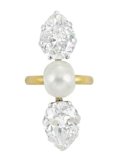 Gold, diamond, and pearl ring by Tiffany & Co., circa 1905.The two old-mine cut pear-shaped diamonds weigh a total of approximately 5.91 cts. Via Diamonds in the Library.