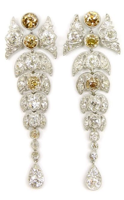 Lovely leafy diamond and colored diamond earrings. Via Diamonds in the Library.