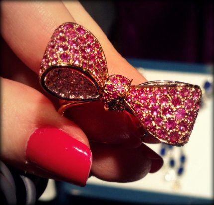 Gold, white diamond, and pink sapphire bow ring by Mimi So. Via Diamonds in the Library.