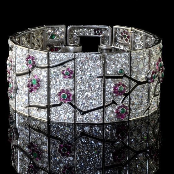 An antique Art Deco diamond and gem set bracelet by Cartier with a pattern of cherry blossom bracelet.