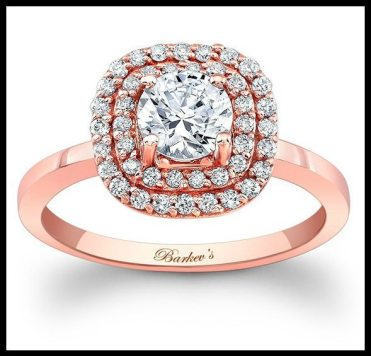 Rose gold engagement ring with a double halo by Barkev's. Via Diamonds in the Library.