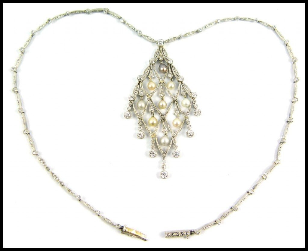 Edwardian diamond and pearl lozenge-shaped necklace, circa 1905. Via Diamonds in the Library.