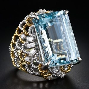 28 carat emerald-cut aquamarine and diamond cocktail ring in two-tone gold, circa 1960s-1980s. Via Diamonds in the Library.