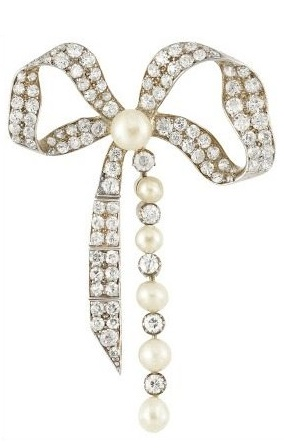 Antique Victorian diamond and pearl bow brooch, circa 1890. Rhodium-plated silver and gold studded with 99 old-mine & rose-cut diamonds, totaling approximately 2.50 carats. Via Diamonds in the Library.