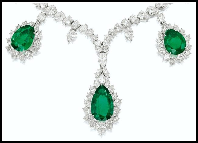 Detail: Harry Winston platinum and white gold necklace with pear-shaped emeralds weighing 10.61, 8.30 and 7.02 carats. The emeralds are wreathed in marquise- and pear-shaped diamonds and hang from a necklace set with many more pear- and marquise-shaped diamonds. Total diamond weight: 32 carats. Via Diamonds in the Library.