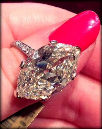 """Antique engagement ring centering a faint yellow 9.55 carat """"moval"""" diamond. Via Diamonds in the Library."""