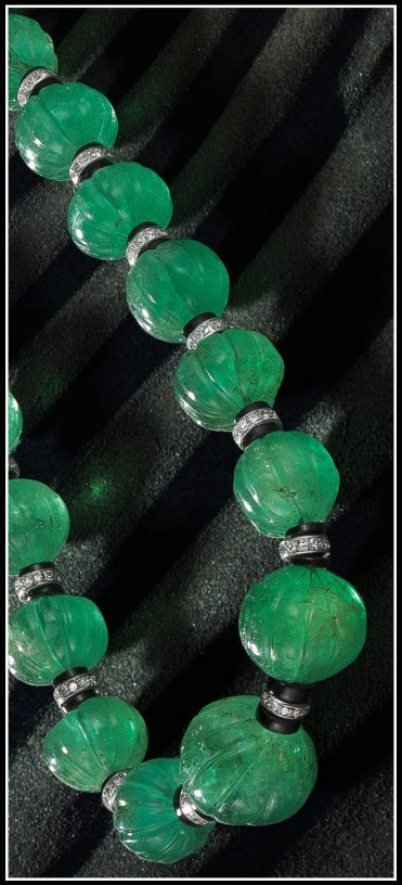 Detail: Art Deco Cartier emerald carved bead necklace with onyx, and diamonds. Circa 1925. Via Diamonds in the Library.