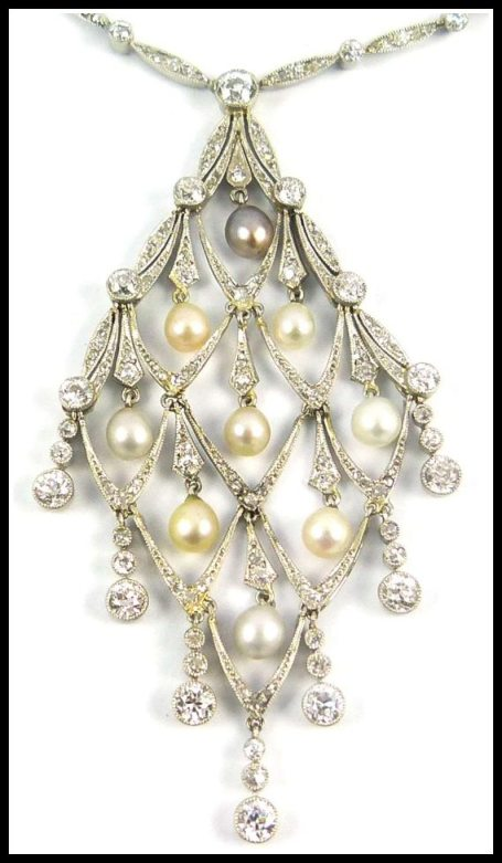 Pendant detail: Edwardian diamond and pearl lozenge-shaped necklace, circa 1905. Via Diamonds in the Library.
