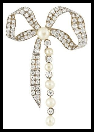 Antique Victorian diamond and pearl bow brooch, circa 1890. Rhodium-plated silver and gold studded with 99 old-mine & rose-cut diamonds, totaling approximately 2.50 carats. The center and one tail of the ribbon are also set with button pearls. Via Diamonds in the Library.