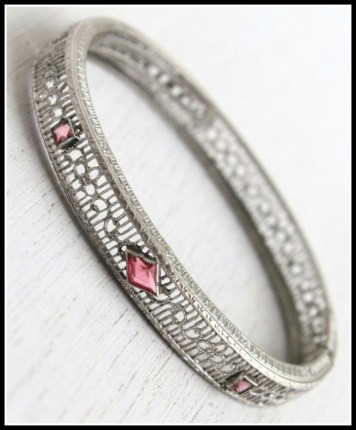 Art Deco filigree and pink stone bracelet. Via Diamonds in the Library's jewelry gift guide.