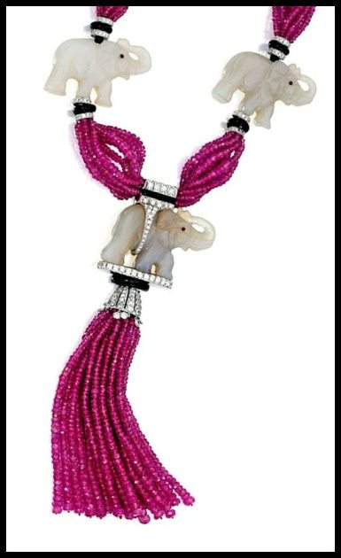 Tassel detail: Jade, ruby bead, onyx, and diamond elephant necklace by Michele della Valle. Via Diamonds in the Library. Tassel detail: Jade, ruby bead, onyx, and diamond elephant necklace by Michele della Valle. Via Diamonds in the Library.