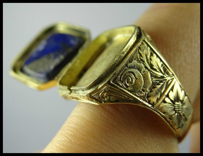 Victorian lapis lazuli locket ring with engraved gold mounting. Via Diamonds in the Library.