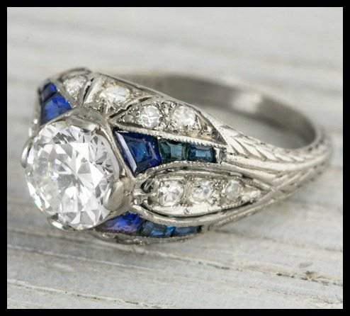 Art Deco sapphire and diamond engagement ring, side view. Via Diamonds in the Library.
