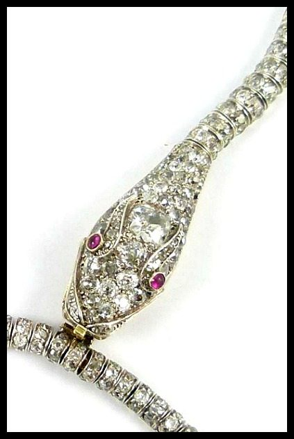 Detail: Antique diamond snake necklace from the late 19th century. Completely flexible with ruby eyes. Via Diamonds in the Library.