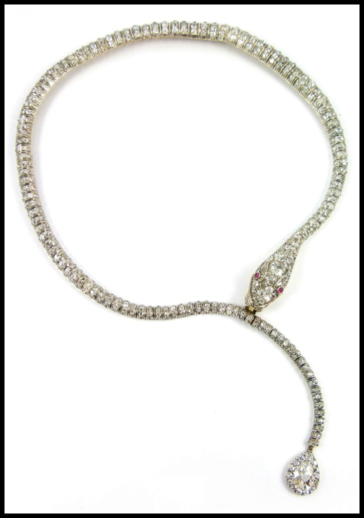 Antique diamond snake necklace from the late 19th century. Completely flexible with ruby eyes. Via Diamonds in the Library.