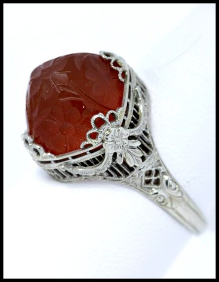 Carved carnelian and white gold filigree ring.