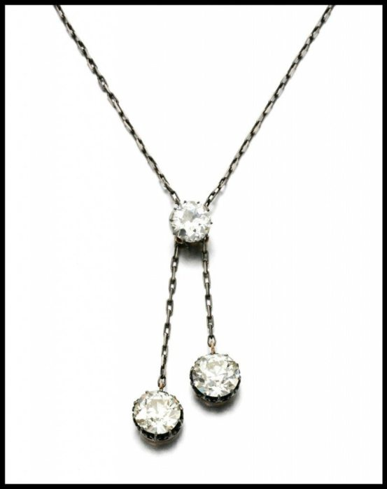 The three circular-cut diamonds weighing 3.22, 5.23 and 5.55 carats are detachable and may be worn as a pair of earrings and a ring with additional fittings.