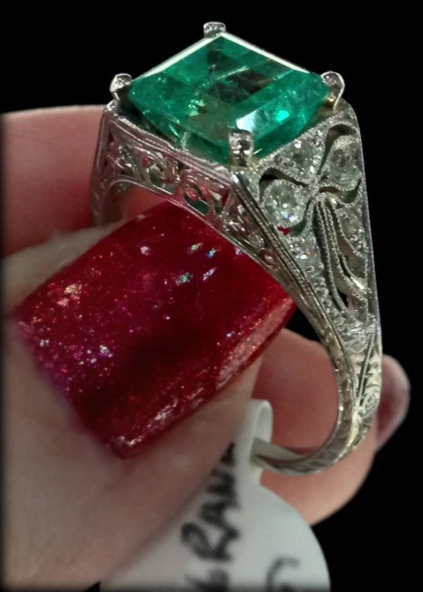 Antique emerald and diamond ring with bow detail.