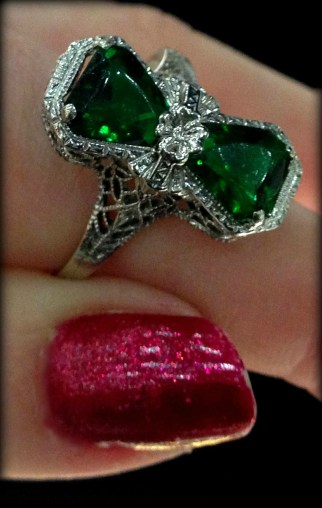 Antique green stone and filigree ring with flower detail.