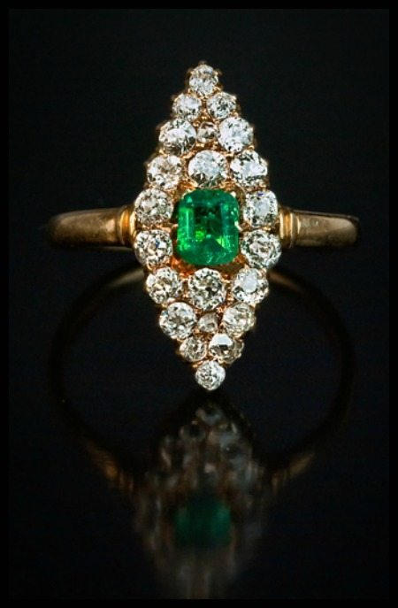 Antique emerald and diamond navette ring in gold. Russian, circa 1899.